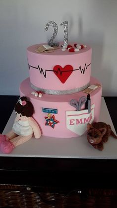 21st Nursing Cake - accompanied by her favourite doll as a child and her pet cat!   Cake by Homemade By Hollie