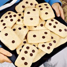 Dominoes made from sugar cookie dough and milk chocolate chips.  You could probably use another kind of dough though.  Like chocolate chip without the chips.  Maybe? Or reverse them: chocolate dough and white chocolate chips. -Jen
