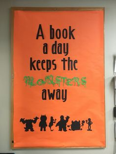 Library bulletin board, library display, a book a day keeps the monsters away, Halloween decorations.