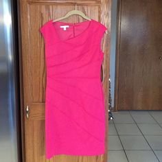 Hot pink dress NWT, size 8 Hot pink dress NWT, asymmetrical neckline, flattering style. Polyester, 2% spandex. 34 inches in length London Times Dresses