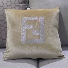"""COMING SOON FENDI logo velvet glitter pillow These fabulous """"FENDI"""" velvet pillow cases will be arriving to our store in a few weeks!!! They come in a variety of colors and have FENDI logo on the front EMBELLISHED in rhinestones. They measure 18""""X18"""" and will absolutely dress up any sofa, bed, chair etc... PLEASE LET US KNOW WHAT YOU THINK❤️ FENDI Accessories"""