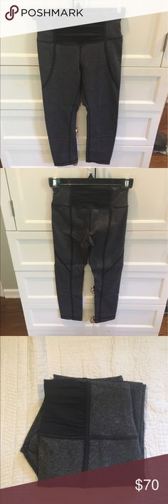 Lululemon Leggings Black and grey cropped leggings. Previously worn and tag was taken out because pants can be reversed. In good condition! Contains a small front pocket to hold keys on a run. Open to reasonable offers through feature! lululemon athletica Pants Leggings