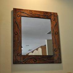 Rustic cedar wall mirror with a western flavor