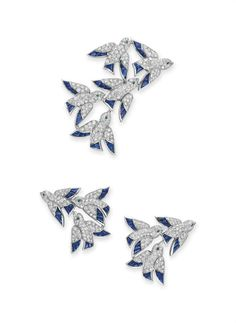 """A set of diamond, sapphire and emerald """"en vole"""" Comprising a brooch, designed as a flock of circular-cut diamond birds, each with calibré-cut sapphire detail and circular-cut emerald eyes; and a pair of ear clips en suite, mounted in 18k white gold, with French assay marks and maker's mark Each signed Cartier.jewelry, by Cartier #christiesjewels"""