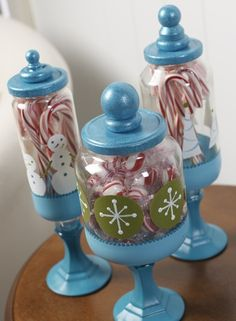 This is made from paint, 99cent store candlesticks  wood shapes (made into finials) glued to the lids of the jars (Mayonaise, spaghetti sauce, etc..)