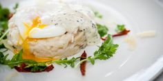 Mark Dodson's creamy smoked haddock risotto is served with sun-dried tomatoes, Parmesan and a poached egg