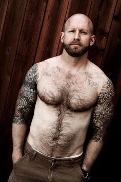 chest hair and tattoos.