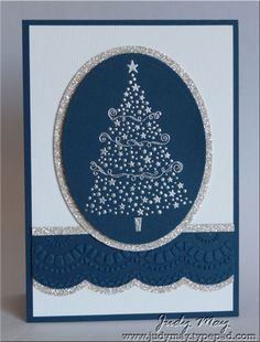 handmade Christmas card ... clean and simple design ... navy blue, silver and white ... luv the formal look .,.. silver embossed Christmas tree on an oval with silver glitter paper mat ... band of navy with large scalloped bottom edge, silver glimmer paper matting and beautiful embossing folder lace edging ... great card!! ...Stampin' Up!