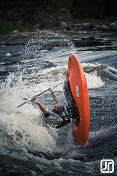 Stephen Wright with a huge loop in the top hole of Push Button in the new 2013 Jackson Kayak All-Star.
