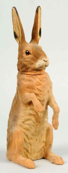 Papier mache rabbit candy container, felt-like body (perhapsit has a) flock covered body.