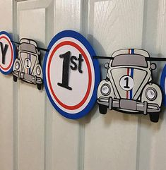 This is for a retro Herbie inspired birthday banner. Banner features two VW bugs that can be customized with an age. Pennants are made with three layers of cardstock in red, blue, and white. The letters are made with black glitter cardstock. Colors and wording are fully