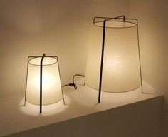 Expressed wire frame table lamp with fabric lampshade