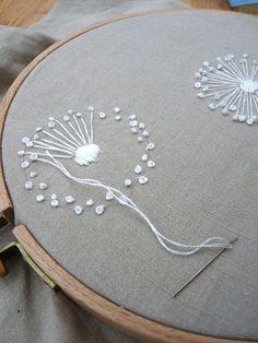 creating my dandelion embroidery on vintage linen mangel cloth