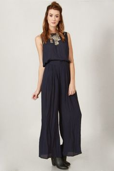 In the Navy Jumpsuit Navy wide leg jumpsuit. Features a cutout on back. Zipper closure on back.