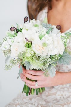 green and white bouquet - photo by Laura Witherow Photography http://ruffledblog.com/a-midsummer-daydream-editorial #weddingbouquet #bouquets #flowers