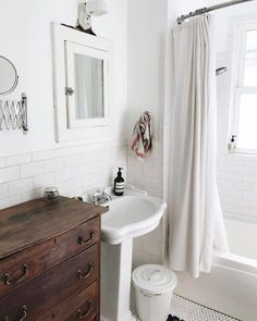 Vintage touches in the bathroom. I love the white and wood together.
