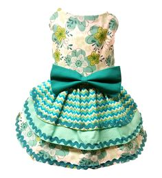 Aqua and green dog dress with triple layer skirt. Three different fabrics used on skirt accented with fabric aqua bow at waist. Lined to insure comfort, Velcro closures at neck and chest for easy adju