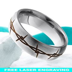 Hey, I found this really awesome Etsy listing at https://www.etsy.com/listing/266320478/titanium-wedding-band-8mm-barb-wire