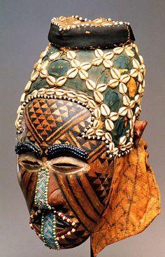 Democratic Republic of the Congo; Kuba peoples Ngaady-A-Mwaash mask Wood, beads, fiber 38.1 cm  Masquerades...