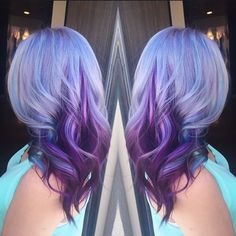 Beautiful blue violet hair color melting into dramatic purple hair color. There's no watermark on this photo. We are searching for a credit. hotonbeauty.com color melt hair painting