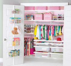 elfa: a second closet solution, very different in mood [girly] but also features some items not seen in first photo.  I don't know that this organization system is better than another, but it certainly reveals how much vertical space can be better organized.
