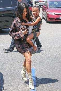 Kim Kardashian wearing Yeezy Season 4 Lace-Up Boots