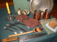 Contents of kitchen box, hand forged spoons,napkin rings, flint and steel kit.