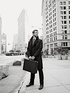 Double-breasted shearling coat ($2,700) and cotton shirt ($355) by Gucci; wool tie ($145) by Hickey Freeman; wool trousers ($498) by John Varvatos; leather shoes ($585) by Dunhill; calfskin briefcase ($9,050) by Louis Vuitton.  Total $13,333