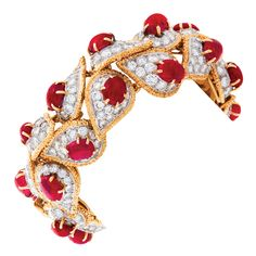 A rare French mid-20th century 18 karat gold, platinum, ruby, and diamond bracelet by Van Cleef & Arpels. The bracelet features 24 cabochon rubies with an approximate total weight of 50.00 carats, and 336 round-cut diamonds with an approximate total weight of 26.50 carats that forms an Indian inspired paisley pattern. Provenance: The Estate of Barbara Hutton, circa 1960s.