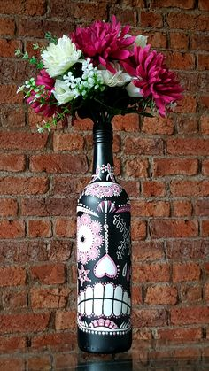 Handmade Mexican Day of the Dead Sugar Skull, decorated bottle. Vase/ candleholder. Pink.