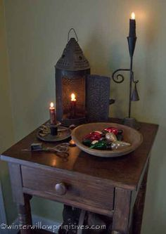Prim Table...with old rustic lantern & candleholders...wooden bowl.
