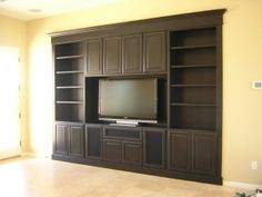love the trim on the bottom and all around really.  the complete built in look.  we can't do cabinets above the tv unless we pull the tv out from the wall...