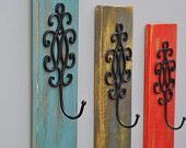 **Find it on Etsy~ by revampedandrevived** Hand crafted distressed pallet wall décor with a swirl design hook. A great way to add some color to any room. Hang a scarf, hat, purse, jewelry, towel, etc..