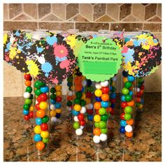 """Paintball invites - 8"""" plastic tube filled with 'paintballs' (gumballs)"""