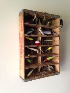 Old fishing lure display. Bottle crate.
