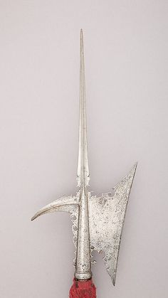 Halberd | Italian | The Met Date:ca. 1525 Culture:Italian Medium:Steel, wood, textile Dimensions:L. 93 3/4 in. (238.1 cm); L. of head 21 1/4 in. (54 cm); W. 9 7/16 in. (24 cm); Wt. 4 lbs. 2.1 oz. (1873.9 g) Classification:Shafted Weapons Credit Line:Gift of William H. Riggs, 1913 Accession Number:14.25.338
