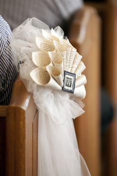 Tulle + Paper = pretty pew decor. Photography by chelseadavisphoto.com