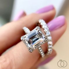 How stunning is this Dantela collection diamond engagement ring from Tacori?  A crown of diamonds surrounds an emerald cut diamond, adding so much depth and dimension. Robbins Brothers Sku: 0390285