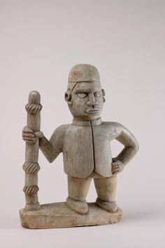 Object type  grave sculpture Materials  rocks > steatite Legend  This stone memorial statue depicts a chief with a beautifully decorated chiefly staff. The European coat is an expression of 'modernity'. Place of collecting  Angola > Zaire (province) Culture  Mboma