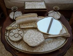 Beautiful Dressing Table Set by Regent of London, £30.00 by Vintybits: Beautiful 8 piece Regent of London dressing table vanity set, made in England. Gold tone metal, covered with pretty gold brocade fabric. Set comprises, tray (~10 inches by ~14 inches), jewellery box, bevelled mirror, lipstick holder, 2 candlesticks. hairbrush, and clothes brush. Has a little age related tarnishing but in very good vintage condition. SAVE ON P&P - buy more than one item on the same day from Vintybi...