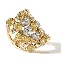 Six rows of fancy shaped yellow diamonds alternating with white diamonds set in 18K yellow gold make up a one-of-a-kind ring. De Boulle Collection