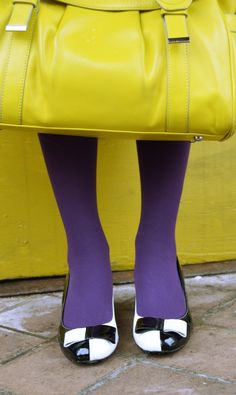 Brightening up this gloomy weather with bold colors and retro mid-heels.  Seen here: Two-tone patent bow heels by @Vogue Footwear. Purple tights. Yellow satchel.