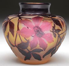 James D. Julia, Inc. -  Galle Floral Cameo Vase. Galle vase is decorated deep purple cameo stems and leaves descending from the mouth and supporting lovely red cameo flowers. The decoration is set agianst a frosted yellow and cream background