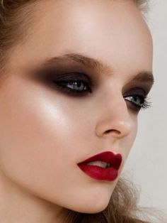 Blackened and Blurred Smokey Eyes, and Matte Red Lips. Editorial Makeup.