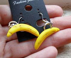 Banana earrings, handmade in 1:12 scale from polymer clay by me at The Fairy Factoree: https://www.facebook.com/fairyfact?pnref=lhc