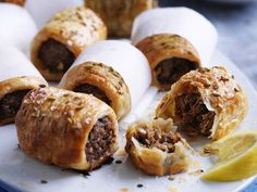 Middle Eastern sausage rolls recipe - By Australian Women& Weekly Goat Recipes, Snack Recipes, Cooking Recipes, Savoury Recipes, Greek Recipes, Savoury Pies, Indian Recipes, Middle East Food, Middle Eastern Recipes