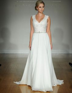Allure fall 2016 wedding gown with plunging V neckline, beaded belt and lace detailed straps and bodice with simple flowing skirt | https://www.theknot.com/content/allure-wedding-dresses-bridal-fashion-week-fall-2016