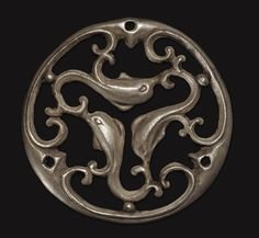 Roman openwork silver triskele phalera with dolphins