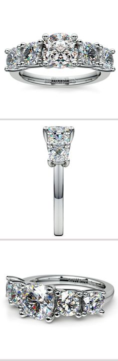 Two 1/4 carat round cut diamonds and two 1/8 carat round cut diamonds are perfectly matched and prong set in this platinum diamond engagement ring setting, accenting your choice of center diamond.