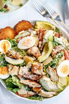 Love Chicken Caesar Salad but want to cut down on the calories? This Chicken and Avocado Caesar Salad made with a low in fat healthier dressing, with grilled chicken and crunchy ciabatta croutons, looks beautiful.